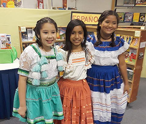 students in native costumes