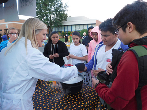 students and teacher doing witches' brew