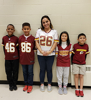 teacher and students in Redskins jerseys