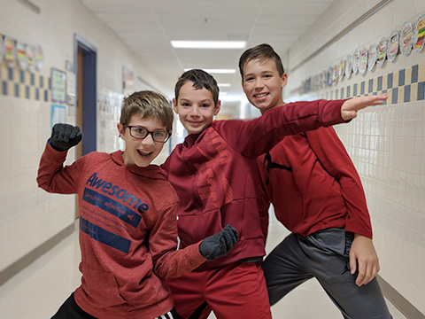 three boys wearing red