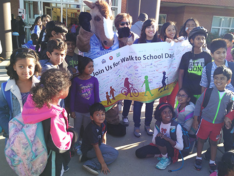 students with walk to school poster