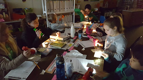 students exploring light with prisms