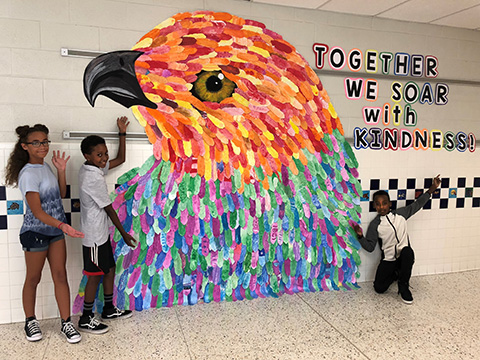 giant hawk with students