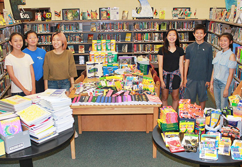 National Junior Honor Society officers with donations for Houston high school