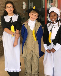 students in colonial dress
