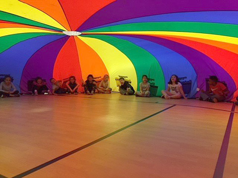 students with parachute