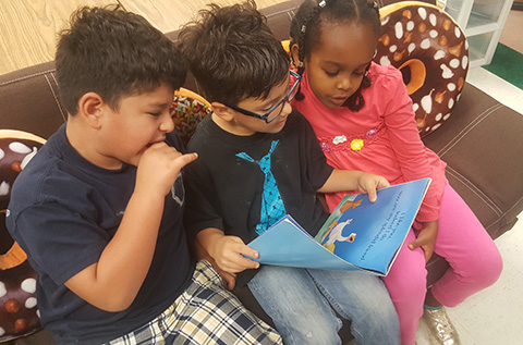 students reading a picture book