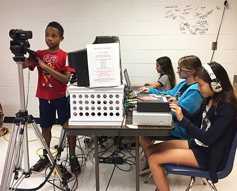 students broadcasting the news