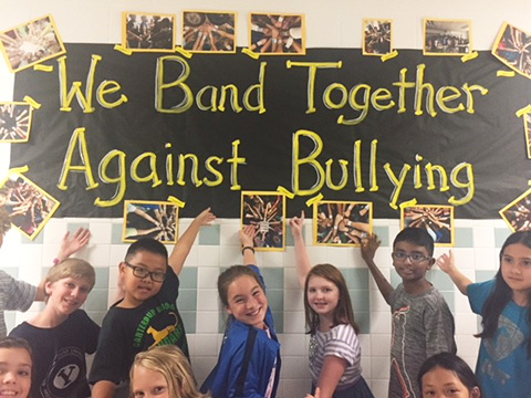 students with anti-bullying sign