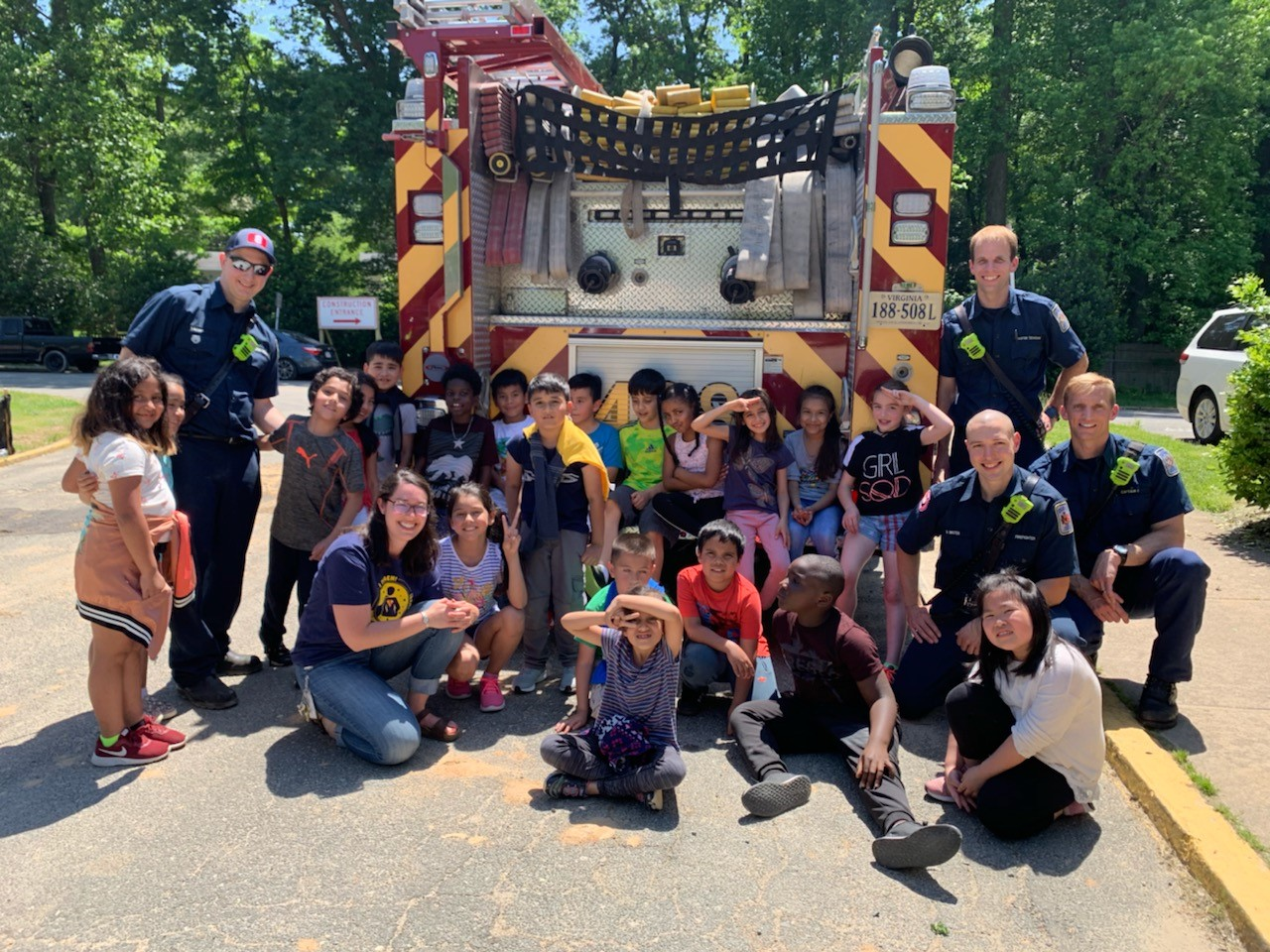 second graders with firefighters