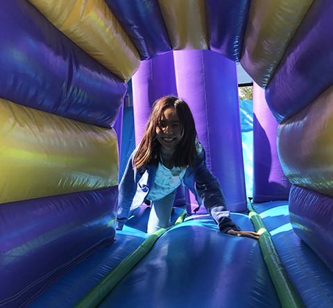 student in an inflatable tunnel