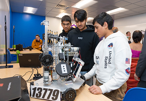 students with big robots