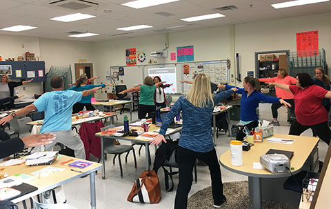 teachers doing warrior pose