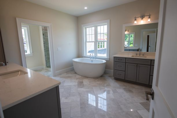 Bathrooms inside the home feature high-end features and upscale tile work.
