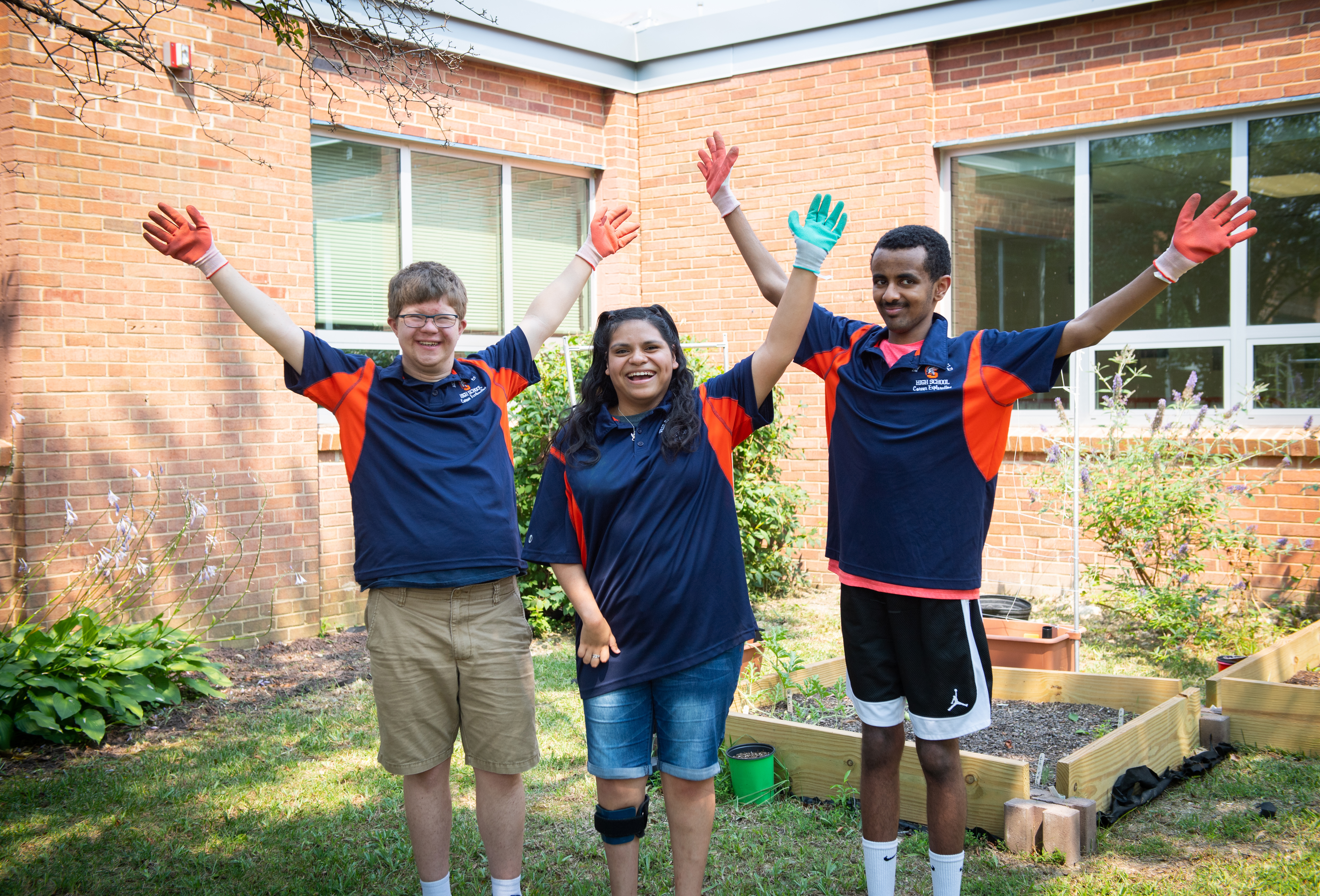 Getting the job done: John, Ariana and Yisak worked with other students to transform this green space.