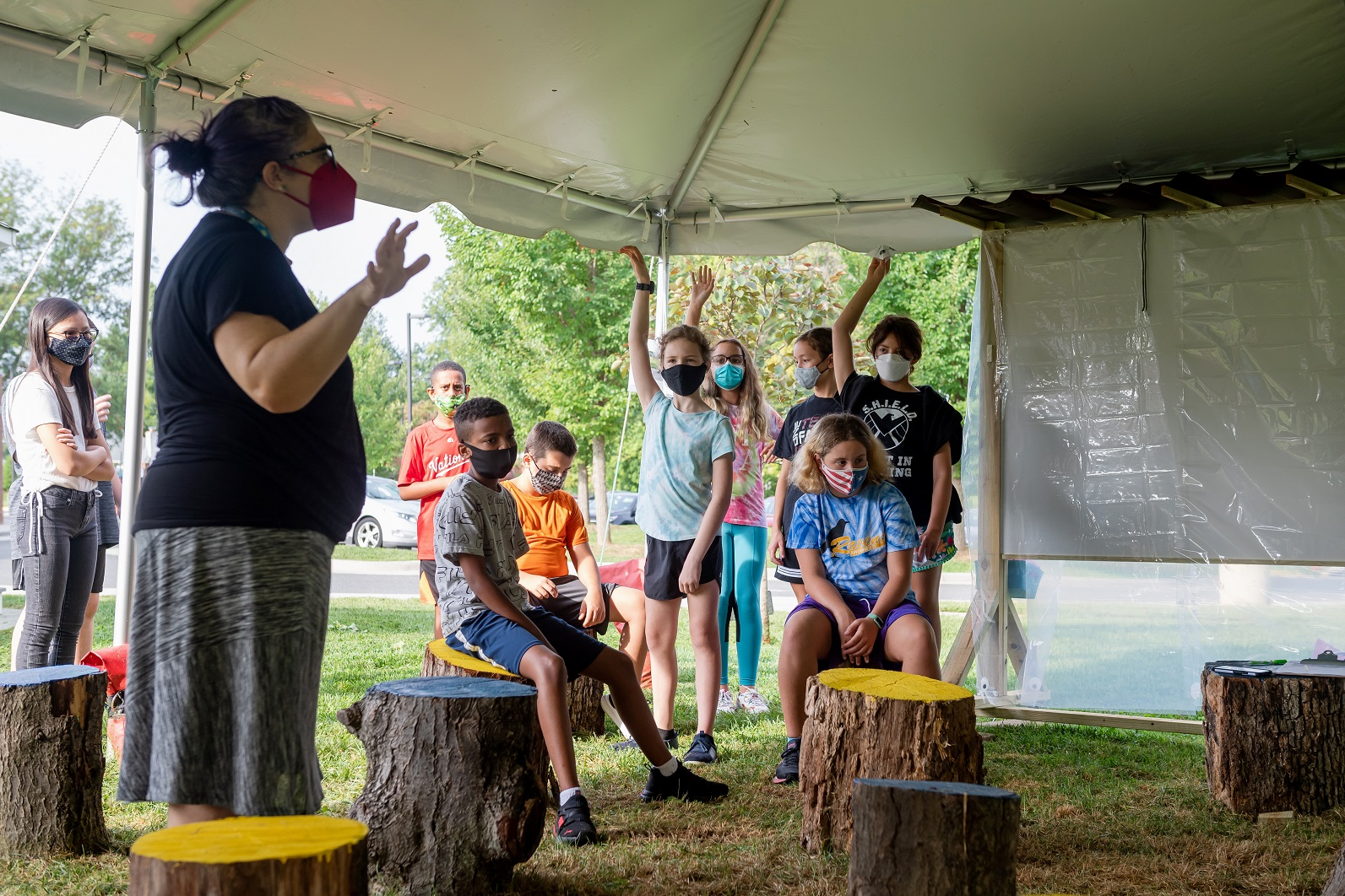 Teacher Andrea Trumbull works with Advanced Academic Program sixth grade students in the outdoor classroom at Ravensworth ES.