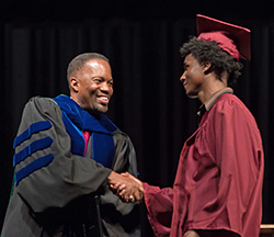 Anthony Terrell with graduating student