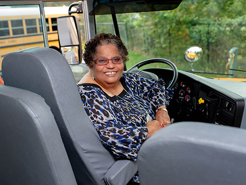 bus driver behind the wheel