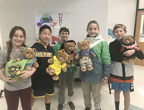 students with bears