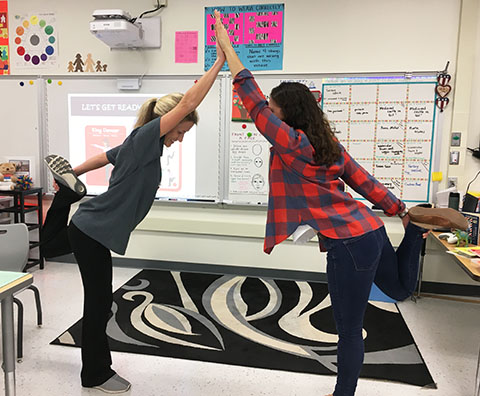 teachers practicing yoga