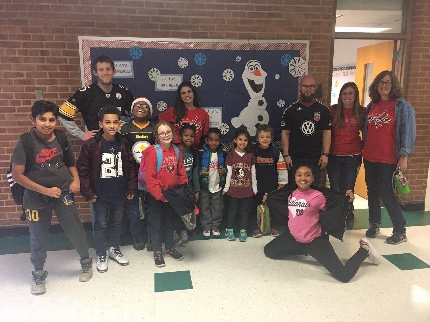Students and staff wearing their favorite team jersey.