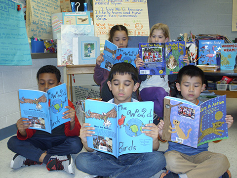 students reading self-published books