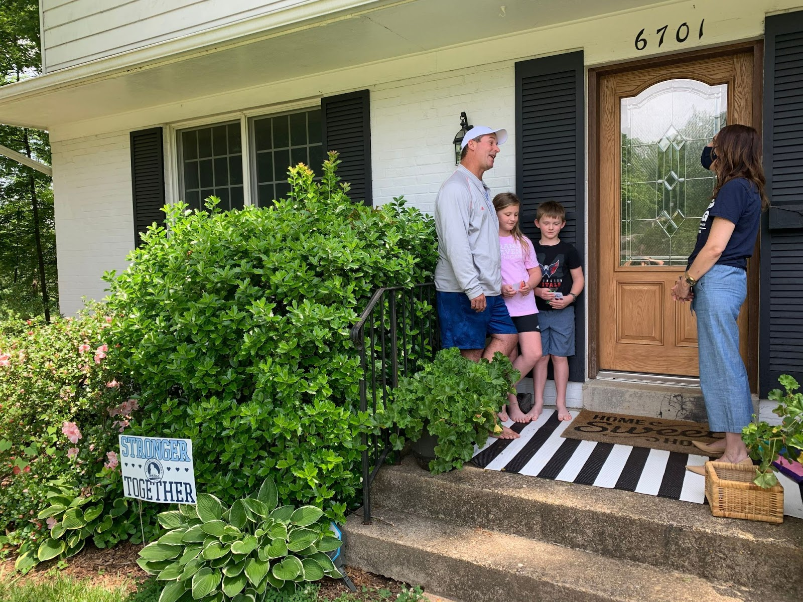 Dr. Sheers visits the McDonald family on their front porch.