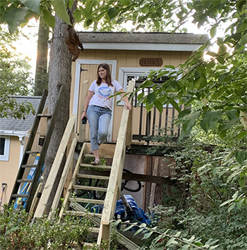 Williams on the steps of her treehouse