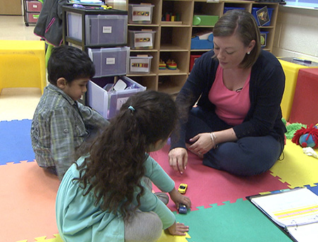 Photo of teacher working with students in a small group