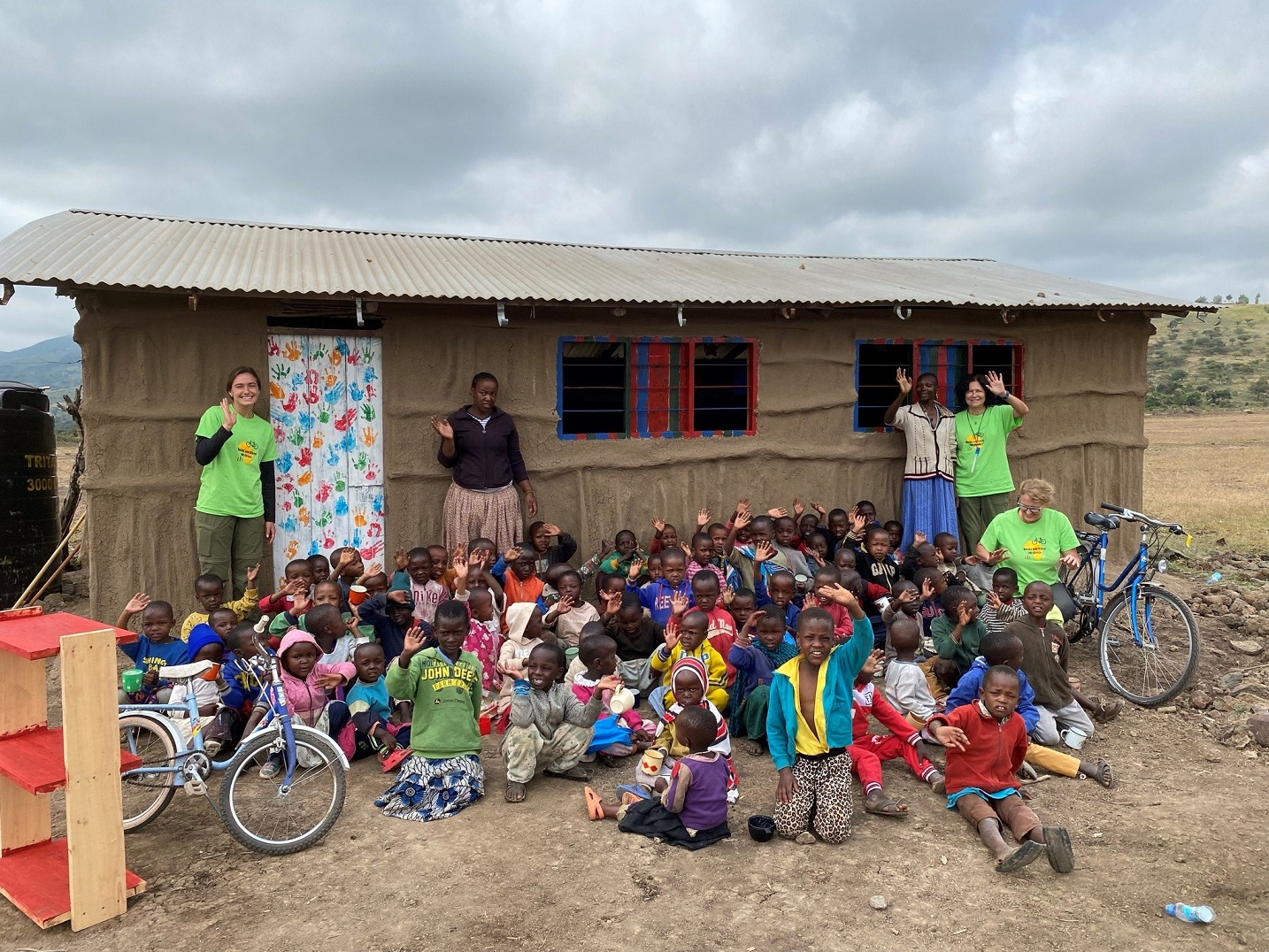 The group outside their schoolhouse after decorating the door and window frames.