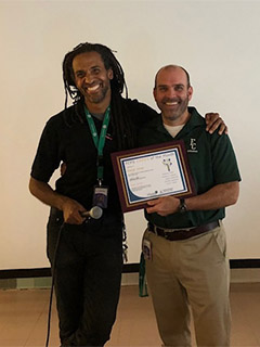 a photo of FCPS Cares recipient Daryl Jones (left) and Falls Church HS principal Ben Nowak.