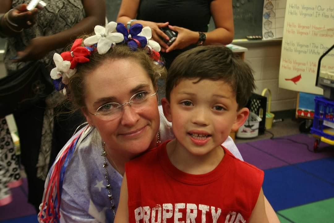Logan pictured with a kindergarten teacher in his early days with FCPS