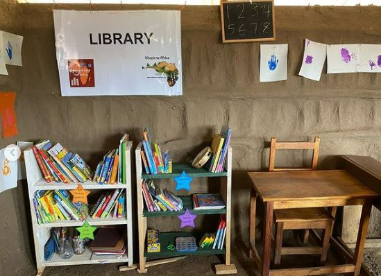 The new library fully stocked with dozens of donated books.