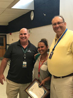 a photo of HR Communications Manger Craig Maniglia (left), FCPS Cares Recipient Celina Amaya (middle), and nominator Danny Adams.