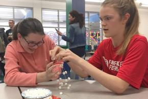 students construct a model of the Eiffel tower