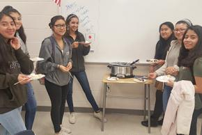 students enjoying fondue