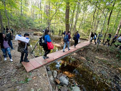 Lee High students travel to their research site at Hidden Oaks Nature Center.