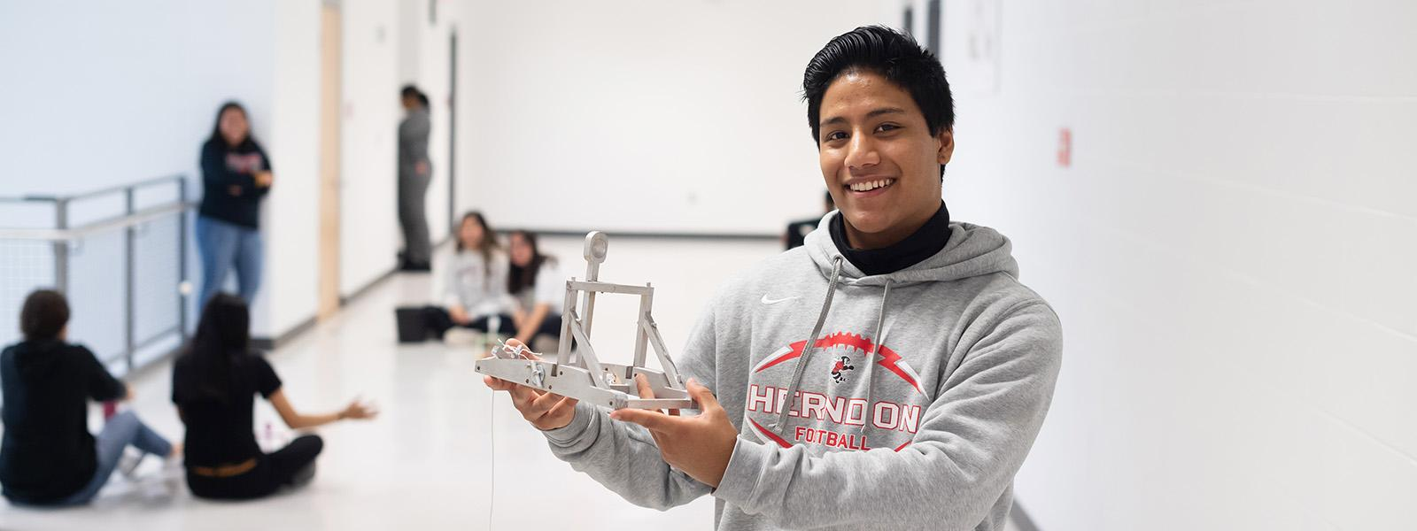 Building on what they learned in physics class, Herndon High School students designed and constructed catapults.