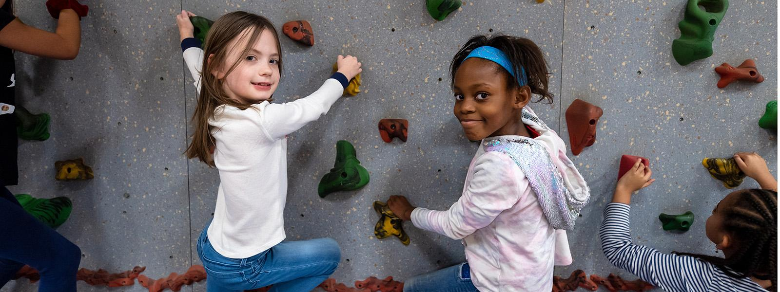 Newington Forest Elementary School students rise to new heights on the school's climbing wall.