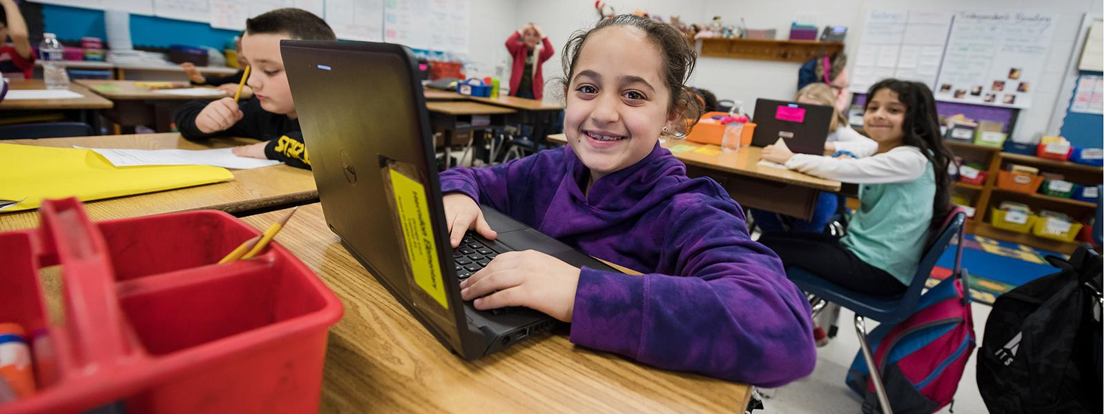 School-based employees are gearing up to help students with online learning; here, Herndon Elementary School students use multiple ways to learn.