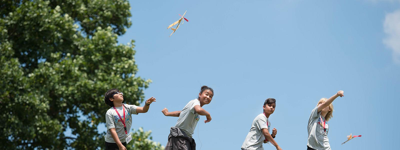 Students in Tech Adventure Camp launch the planes they designed and made using STEM skills.