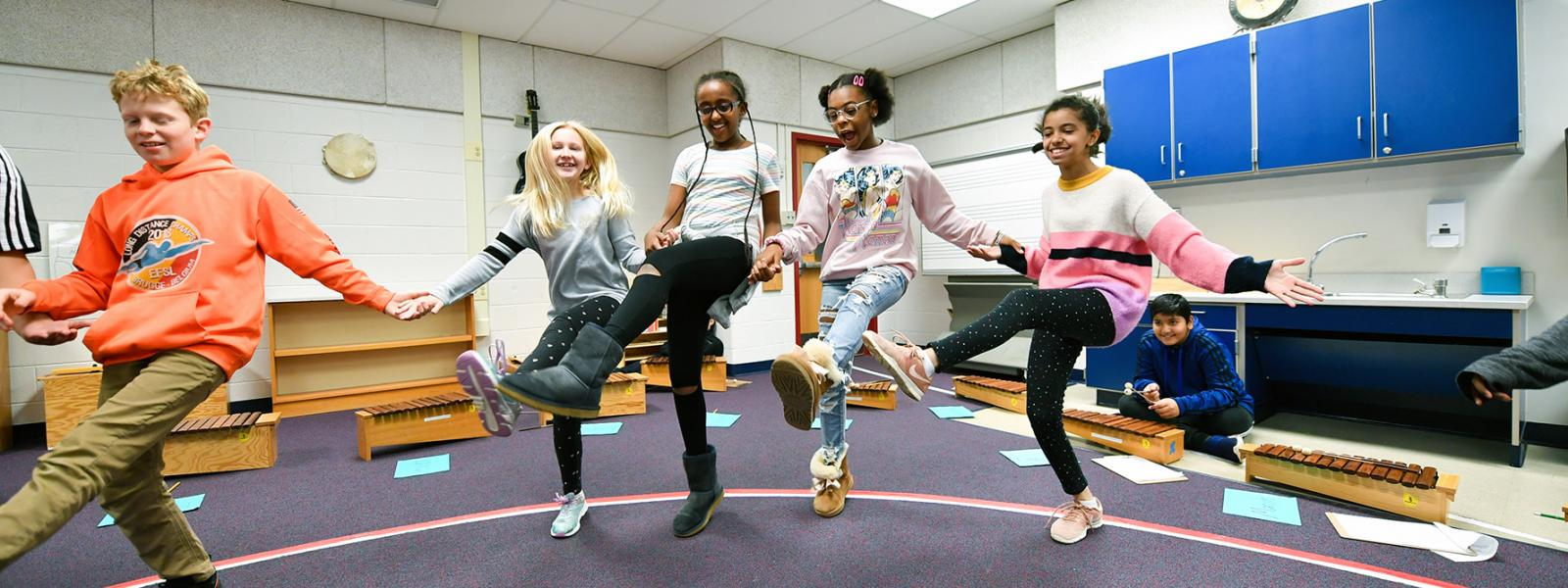 Freedom Hill Elementary School students blend music and physical education during a unit on dance.